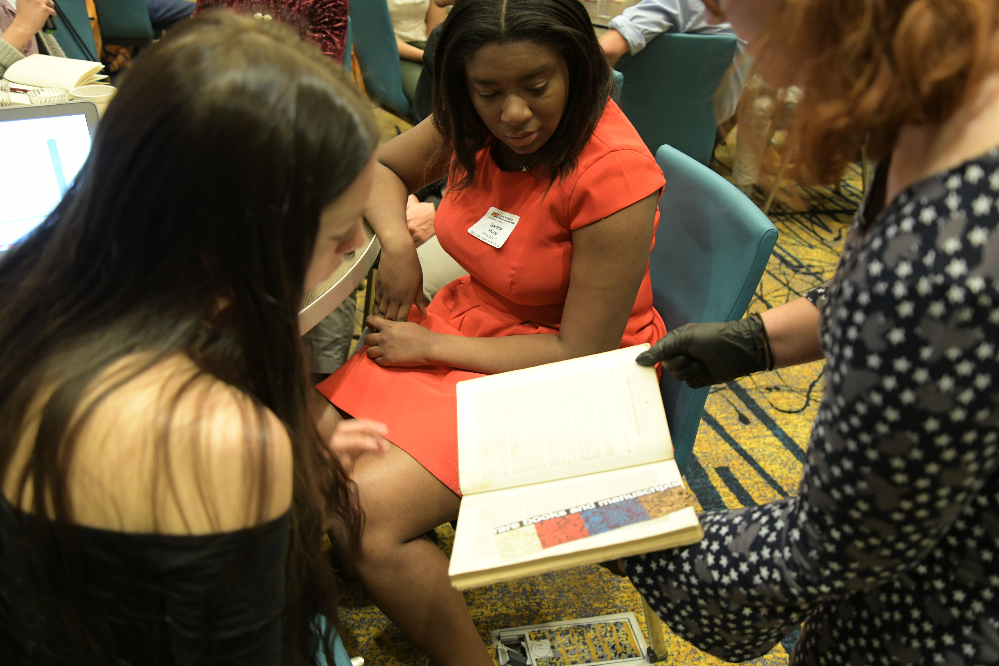 a diverse group of students views a historic document during the 2018 annual symposium of race and the american story